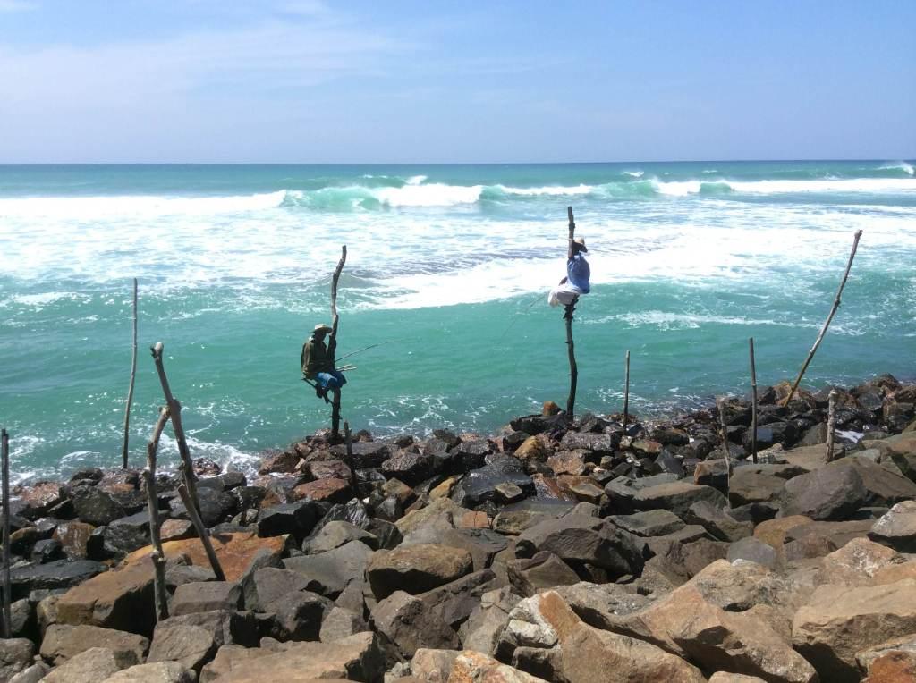 Pole fishermen by Gloria DeLuca