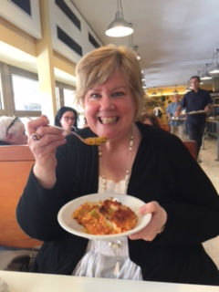 Elizabeth eating lasagna in Florence