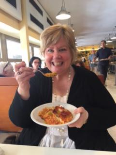 Elizabeth eating lasagna in Florence