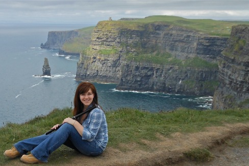 Kieran with flute at the Cliffs of Moher